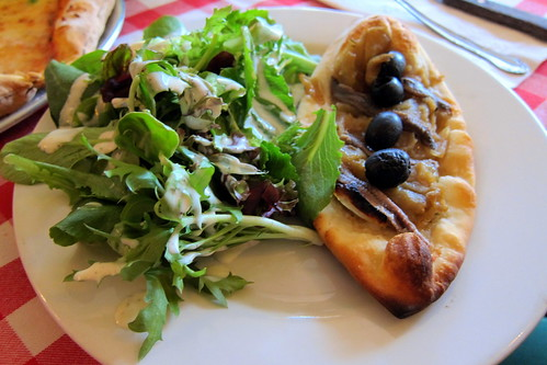 La Pissaladiere: caramelized onions pie with anchovies and black olives
