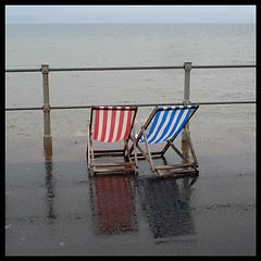 seaside 'fun' (Philip Watson) Tags: sea cold wet rain seaside deckchair prom promenade bleak miserable railings sidmouth eastdevon seasidefun callthisasummer