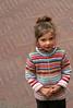 timido sorriso (★silviacafarelli★) Tags: pink portrait color girl lines sweater colore bricks tourists patch toscana ritratto strips cerotto righe bimba sangiminiano turista tuscan bambina mattoni maglione