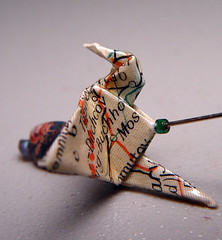origami earrings made from a map