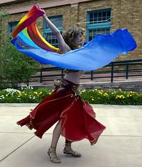 Veiled (karenturner) Tags: blue red yellow dance colorado bellydancer denver belly twirl swirl 2008 streetfair manitousprings d300 carriee 100strangers