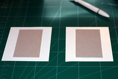 Adhering the chipboard to patterned paper