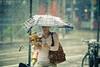 the rain dance (tomms) Tags: street woman toronto canada coffee rain dance donuts canon350d rebelxt timhortons mccaulstreet 135mm2l