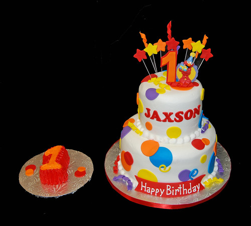 colorful 1st birthday cake for an Elmo themed celebration