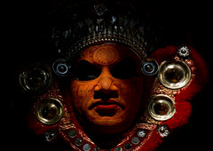 Portrait Of A Theyyam Artist With Traditional Makeup On His Face Dressed For The Ritual, Thalassery, India (Eric Lafforgue) Tags: light red portrait orange sun india black canon religious temple democracy worship vishnu god indian religion makeup kerala dancer indie ritual hindu indi indien hind indi inde hodu southasia indland  hindistan devam indija   ndia theyyam hindustan kannur kasargod teyyam  theyam 2683  lafforgue   ericlafforgue hindia  theyyattam bhrat  theyyaattam thallicherry kolathunadu indhiya bhratavarsha bhratadesha bharatadeshamu bhrrowtbaurshow  hndkastan