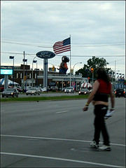 A Sasquatch Sighting (gabreela) Tags: ford crazy traffic americanflag michiganave buttcrack carrie carlights sasquatch fatman crossingstreet cloudyday overweightman dearbornmichigan