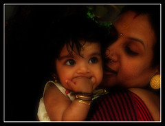 Mother and Child (Midhun Manmadhan) Tags: portrait baby cute love eyes child mother culture relationship innocence tradition motherhood unconditionallove canonpowershots3is midhunmanmadhan