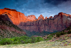 The Towers and Temples of the Virgin (Phijomo) Tags: nature sunrise landscape outdoors nikon scenic zion zionnationalpark redlight stormclouds westtemple altarofsacrifice d80 thesundial nikond80 towersofthevirgin towersandtemplesofthevirgin