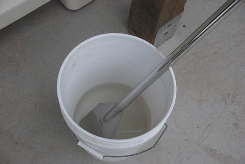 Bucket of sulfite solution. The really tiresome thing is that everything that touches the grapes has to be sterilized with sulfite solution -- again and again and again. Im starting to smell like Lucifer. This is the paddle that I use to stir the grapes and, hopefully, activate the fermentation.