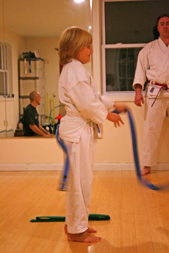 Removing his blue belt