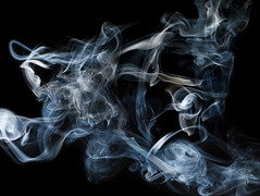 Smoke on black (Sulla Roman) Tags: blue wallpaper abstract color colors canon spiral fire colorful waves pattern wind patterns smoke air flash curls windy burning flame torch burn heat smokey abstraction curl 2008 incense turbulence currents 1740l icefire offcameraflash artsmoke 400d impressedbeauty
