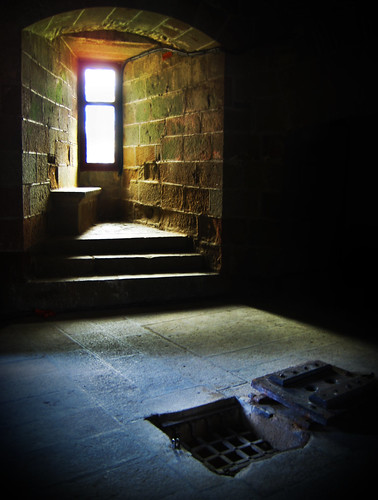 The hatch of a prison set into the floor in the Castle of Fougères, France.