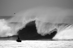 Watch your back (Daniel Moreira) Tags: ocean sea bw white black portugal branco mar wave pb preto pedra branca ericeira oceano onda bodyboarder canonef100400mmf4556lisusmlens