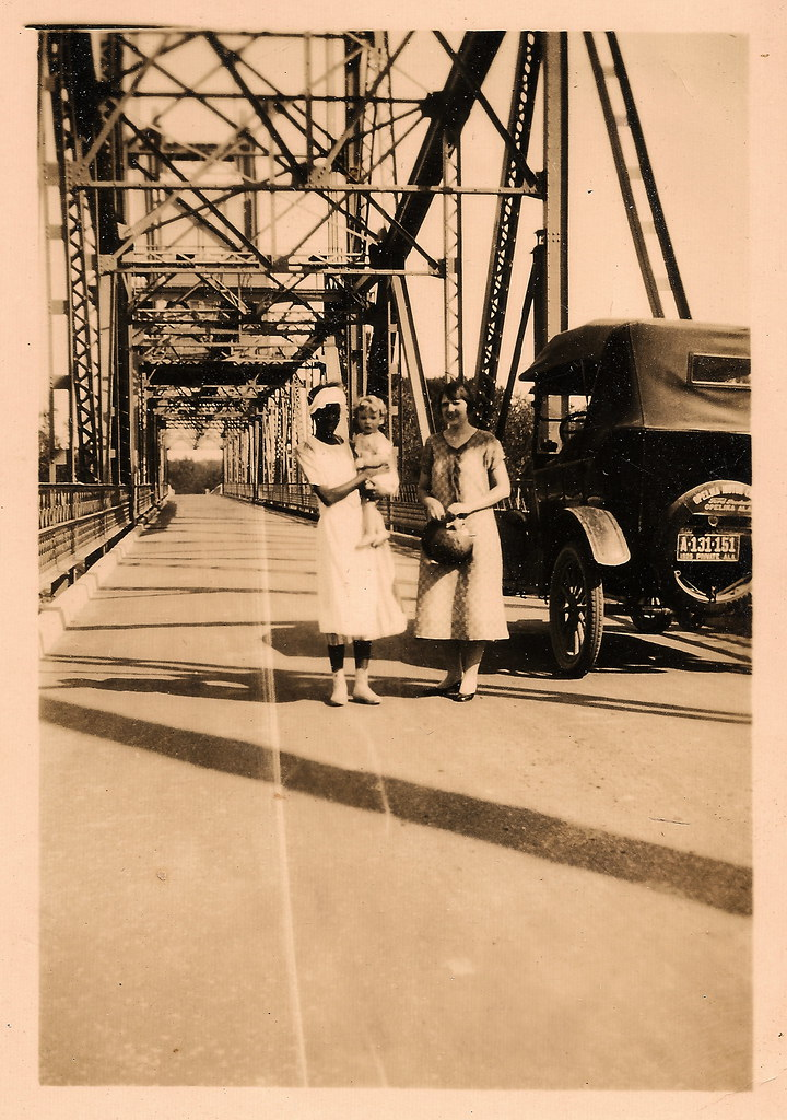 Two women and child on bridge