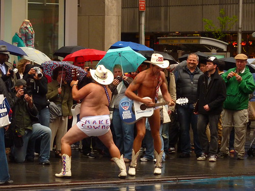 Naked cowboys in the rain (Times Square)