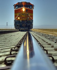 long train coming down the tracks (JoelDeluxe) Tags: railroad blue red newmexico train transport tracks canyon nm joeldeluxe hdr bnsf abo route60 abigfave