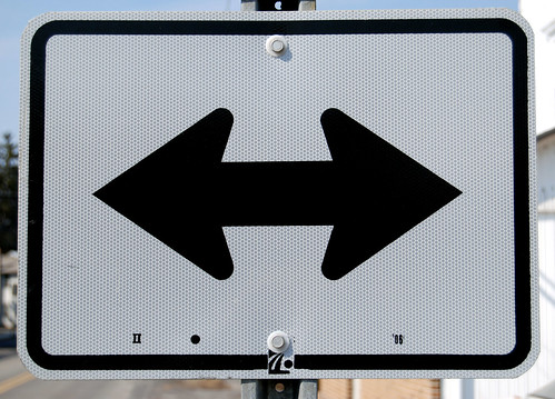 Road sign indicating left or right turn is permissible