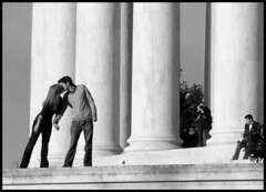 A Kiss at the Jefferson Memorial (starbuck77) Tags: blackandwhite bw woman monument girl beautiful dc washington engagement women kiss couple pretty photographer streetphotography bodylanguage romance dating jeffersonmemorial tidalbasin supershot d80