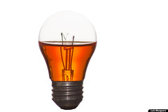 Got a wet idea? (Luis Eduardo ) Tags: claro lighting light orange white blanco luz water glass thread bulb backlight canon contraluz agua crystal illumination clear electricity getty contact electricidad cristal liquid naranja vidrio iluminacion rosca liquido contacto bombillo luismosquera