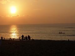 Sunrise at Tiruchendur (Kamala L) Tags: sea people india reflection water silhouette sunrise golden waves seashore tiruchendur blueribbonwinner superbmasterpiece