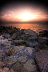 Oostvaardersdijk 2 (pacafl) Tags: sunset sun holland water netherlands rock rocks nederland thenetherlands zon hdr almere stenen oostvaardersdijk sigmaaf1020mmf456hsmexdc pacafl pascalfloris