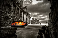 Taxi (tootdood) Tags: street white black sepia geotagged manchester cross taxi canon20d toned geo:lat=5348147 geo:lon=2244751