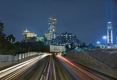 Highway to Buckhead Financial District (James Duckworth) Tags: longexposure railroad atlanta cars night train photoshop buildings georgia lights highway cityscape nightscape timeexposure explore busy marta lighttrails buckhead 152 d300 blendedimage jimduckworth interestningness theperfectphotographer buckheadfinancialdistrict jamesduckworth jamesduckworthphotography