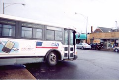 Eastbound CTA Route # 62 Archer / Dearborn and Kinzie bus departing the terminal at Archer and Neva Avenues. Chicago Illinois. April 2003.
