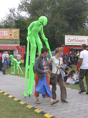 Ever get the feeling someone's watching you? (shaggy359) Tags: cambridge people green festival walking weird women folk alien caribbean 2008 paranoia looming stilts loom