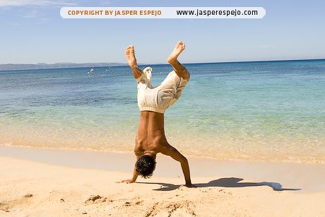A boy does the backflip in Pagudpud beach, Ilocos Norte.