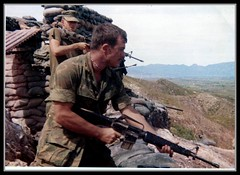 Mad Moment (eks4003) Tags: war asia kill peace rifle vietnam conflict guns marines 1970 ammo m16 nam doves hawks grunts bunkers recon lovebeads hippys hill119 sandgags