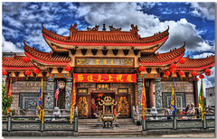 Thien Hau Temple (vgm8383) Tags: city roof sky storm rain clouds canon tile temple rebel losangeles chinatown vietnamese flags ornaments angels blueribbonwinner xti thienhautemple 400d rebelxti platinumphoto superbmasterpiece diamondclassphotographer flickrdiamond megashot platinumheartaward theperfectphotographer goldstaraward mailciler chuabathien