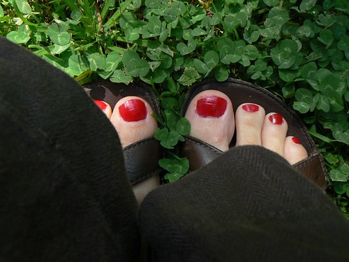 summer equals hastily painted red toenails