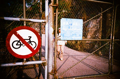 no bicycle (* andrew) Tags: people film sign hongkong lomo lca crossprocessed xprocess gate symbol ct slide 100 agfa taipo 32mm precisa plovercove nobicycle  file:name=2008010703lomolca001jpg