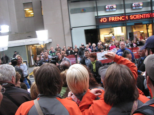 People hoping to be seen on the Today Show's outdoor segments.  Notice the cameramen and the back of Willard's bald head.