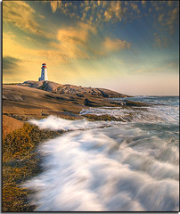 Tower of Peggy's Cove (Dave the Haligonian) Tags: sunset sea sky lighthouse canada seaweed water clouds evening interestingness bravo rocks surf waves novascotia dusk over falling explore peggyscove tilt atlanticocean crooked slanted tilted slat dsc0747 leaningtowerofpeggyscove