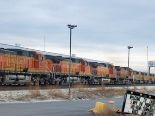 BNSF Railway and Union Pacific westbound trains running side by side. Hodgkins Illinois. January 2007.
