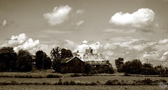 Country Clouds (Dark Scene Photography) Tags: sky blackandwhite ontario canada field sepia clouds countryside farm sony dslr a500