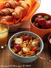 Friday Breakfast (Mashael Al-Shuwayer) Tags: food orange cup breakfast digital canon bread eos 50mm milk corn strawberry juice f14 fresh bananas flakes kelloggs tropicana croissants internationalfood 400d mashael alshuwayer