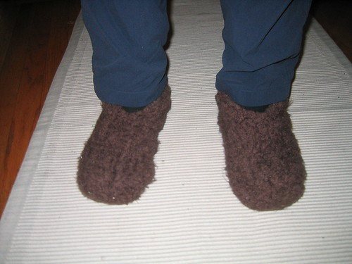 Yoz's feet in brown slippers