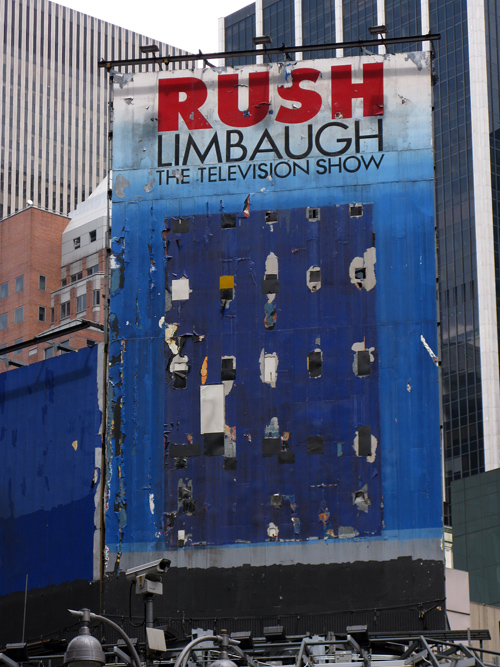worn out Rush Limbaugh billboard in Times Square, Manhattan, NYC
