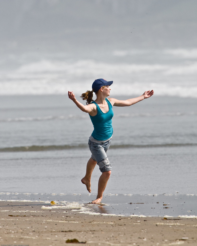 8 of 8 Girl dances at water's edge on Morro Strand State Beach