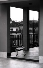 the chair, the view (N A Y E E M) Tags: rooftop chair bangladesh chittagong fujineopanacros leicar62 blackwhitephotos summiluxr80mm nayeemkalam
