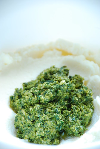 A wad of pesto floating upon a ricotta cloud.