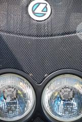 Twin deLIGHTS! (antonychammond) Tags: blue abstract grey lights grille rhizome eyewashdesign abigfave abstractartaward theperfectphotographer trashbit goldstaraward gnneniyisithebestofday rubyphotographer alltypesoftransport