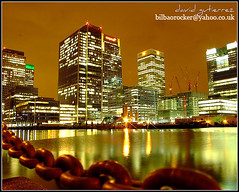 London Docklands Night ; Unchained Lights (david gutierrez [ www.davidgutierrez.co.uk ]) Tags: street city uk longexposure greatbritain travel england sky urban reflection building london tower colors yellow thames architecture modern night skyscraper buildings reflections dark stars geotagged photography lights europe european cityscape darkness unitedkingdom britain dusk walk centre united union cities cityscapes kingdom center structure architectural chain nighttime finepix nights fujifilm docklands metropolis canarywharf topf100 hsbc metropolitan offices londoncity nightfall barclays skycity municipality edifice uklondon londonengland unchained 100faves ukcity urbancity englandengland s6500fd s6000fd fujifilmfinepixs6500fd skystreet