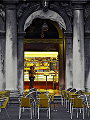 Throat of gold (Sator Arepo) Tags: leica venice architecture bar facade cutout chairs bottles terrace columns lowkey throat zuiko digilux stmark procuratie digilux3 50mmmacroed