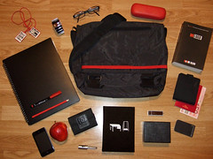What's In My Bag (Tiger Pixel) Tags: wood red black apple colors pencil work bag notebook logo drive glasses mirror dc klein ipod play floor ben wallet no brian flash watch hard nixon case lg peter torch eno naomi usb marker messenger schmidt pocket flooring oblique edition folder sherman armani palette scapular fifth 8gb iphone the strategies 4gb emporio rotolog