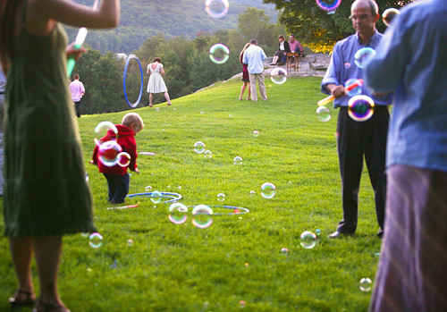 Kids & adults playing with bubbles.