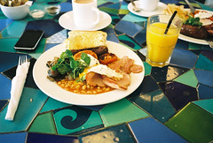 morning after breakfast (lomokev) Tags: food breakfast tomato mushrooms bacon beans nikon brighton tea kodak folk egg knife sausage kodakportra400vc plate tiles friedegg orangejuice portra fryup insideout 35ti iphone nikon35ti fullenglish kodakportra400 kodakportra insideoutcafe roll:name=081105nikon35ti file:name=081105nikon35ti102